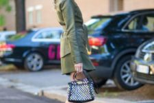 With olive green belted jacket and skirt