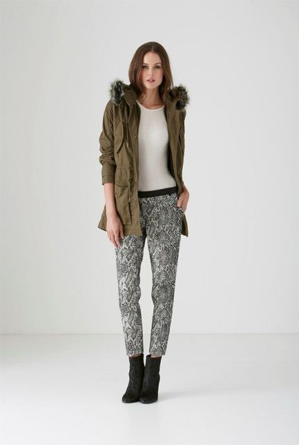 With olive green coat with fur and white t-shirt
