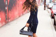 With original navy blue coat, skirt and black bag