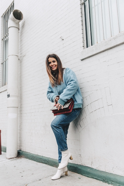 With oversized jacket, jeans and bright color bag