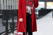 With oversized plaid scarf, black trousers and red chain strap bag