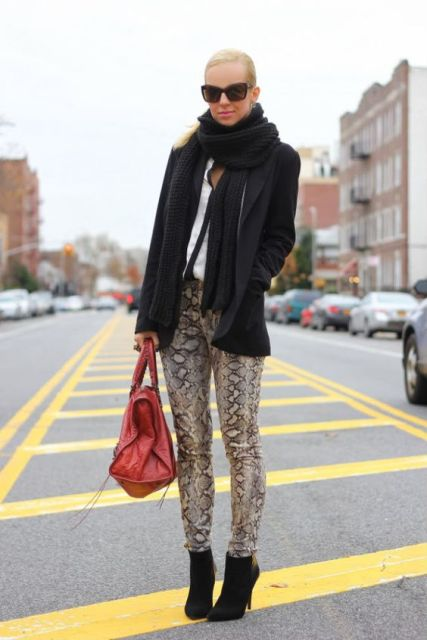 With oversized scarf, black blazer, ankle boots and red bag