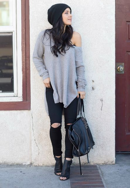 With oversized shirt, skinnies, black ankle boots and big bag