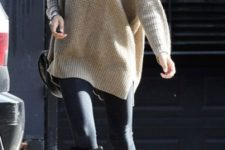 With oversized sweater and leggings