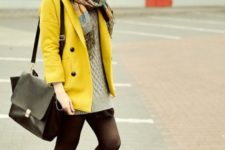 With oversized sweater, scarf and big bag
