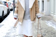 With oversized sweater, white midi skirt and neutral ankle boots