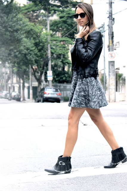 With printed skirt and leather jacket