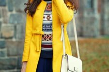With printed sweater and navy blue mini skirt