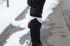 With printed sweater, black pants and beanie