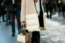 With puffer coat, leather pants and ankle boots