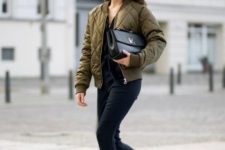With puffer jacket, clutch and white sneakers