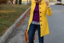 With purple sweater, jeans and brown boots