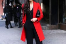 With red coat and black clutch