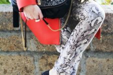 With red coat, chain strap bag and pumps