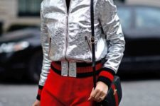 With red pants and mini bag