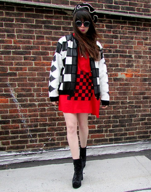 With red printed mini dress and geometric print jacket