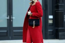 With red skinny pants, animal printed shoes and small black bag