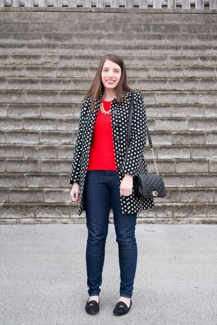 With red sweater, straight jeans, flats and small bag