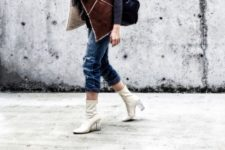 With shearling vest, crop jeans and bag