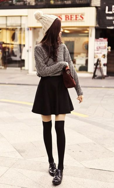 Beanie with skater skirt, gray sweater and flat boots is great outfit for work