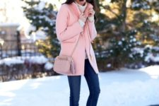With skinny jeans, white sweater and black ankle boots
