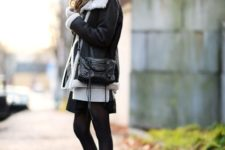 With skirt, black tights, small bag and beanie