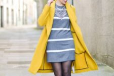 With striped gray dress, statement necklace and black boots