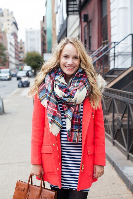With striped shirt and plaid scarf