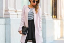 With striped shirt, high-waisted skirt and leather boots