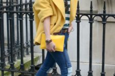 With striped shirt, jeans and yellow clutch