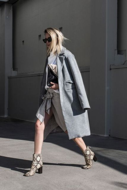 With striped skirt and gray midi coat