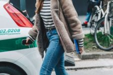 With striped turtleneck, crop jeans and shearling coat