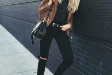 With suede fringe jacket, skinny pants with belt and small bag