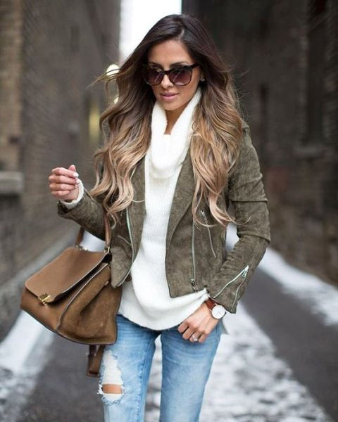 With suede jacket, distressed jeans and brown bag