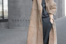 With suede midi coat and white sneakers