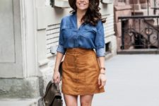 With suede skirt, denim shirt and camel hat