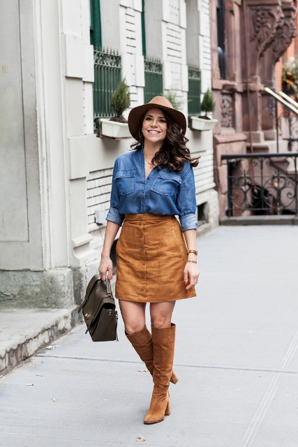 Picture Of With suede skirt, denim shirt and camel hat
