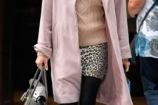 With sweater, leopard mini skirt, black tights and bright pink shoes