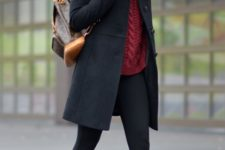 With sweater, skinnies and mini black coat