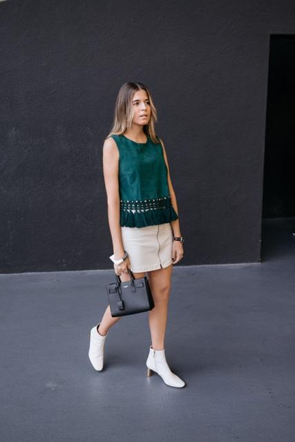 With tassel shirt and mini skirt