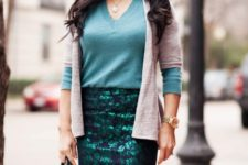 With teal shirt, pastel color cardigan and black bag