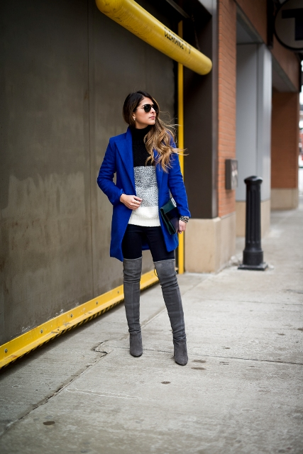 With two color sweater, pants and bright blue jacket