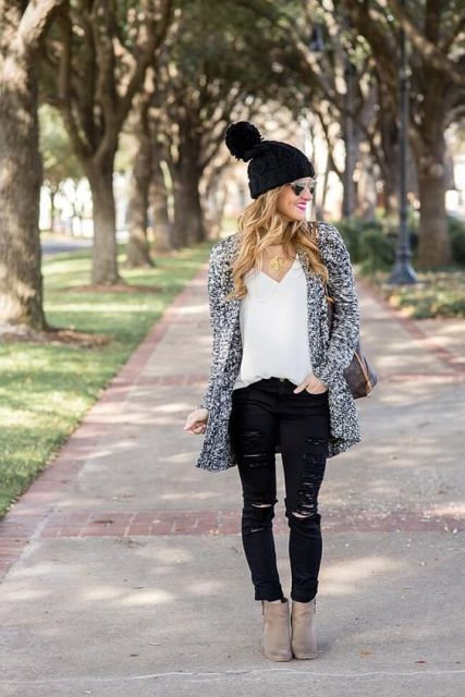 With white blouse, long blazer, distressed jeans and ankle boots