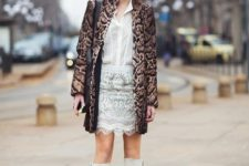 With white blouse, white skirt and printed coat
