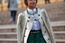 With white classic shirt, statement necklace and metallic coat