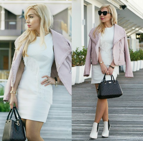 With white fringe dress, pink jacket and black bag