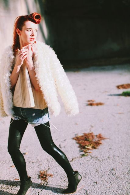 With white fur short coat, sweater, denim shorts and leggings