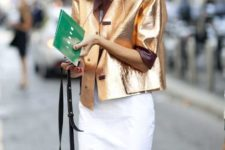 With white knee-length skirt and mini bag