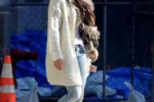 With white long knitted blazer, jeans and fur scarf