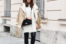 With white long sweater, leather skinnies and black boots